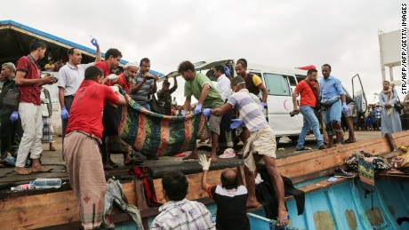 EDITORS NOTE: Graphic content / A picture taken on March 17, 2017, shows bodies of people who were killed in a boat carrying Somali refugees arriving in the rebel-held Yemeni port city of Hodeida. Dozens of people including women and children have been shot dead aboard a boat carrying Somali refugees in the Red Sea off war-torn Yemen according to officials. The refugees were hit by light weapons fire in waters off rebel-held Hodeida but the boat managed to dock in the city's port, an official there said. / AFP PHOTO / STR        (Photo credit should read STR/AFP/Getty Images)