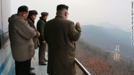 "TOPSHOT - This undated picture released by North Korea's official Korean Central News Agency (KCNA) on March 19, 2017 shows North Korean leader Kim Jong-Un (R) inspecting the ground jet test of a newly developed high-thrust engine at the Sohae Satellite Launching Ground in North Korea. North Korea has tested a powerful new rocket engine, state media said on March 19, with leader Kim Jong-Un hailing the successful test as a ""new birth"" for the nation's rocket industry. / AFP PHOTO / KCNA VIA KNS / STR / South Korea OUT / REPUBLIC OF KOREA OUT   ---EDITORS NOTE--- RESTRICTED TO EDITORIAL USE - MANDATORY CREDIT ""AFP PHOTO/KCNA VIA KNS"" - NO MARKETING NO ADVERTISING CAMPAIGNS - DISTRIBUTED AS A SERVICE TO CLIENTS THIS PICTURE WAS MADE AVAILABLE BY A THIRD PARTY. AFP CAN NOT INDEPENDENTLY VERIFY THE AUTHENTICITY, LOCATION, DATE AND CONTENT OF THIS IMAGE. THIS PHOTO IS DISTRIBUTED EXACTLY AS RECEIVED BY AFP.    /         (Photo credit should read STR/AFP/Getty Images)"