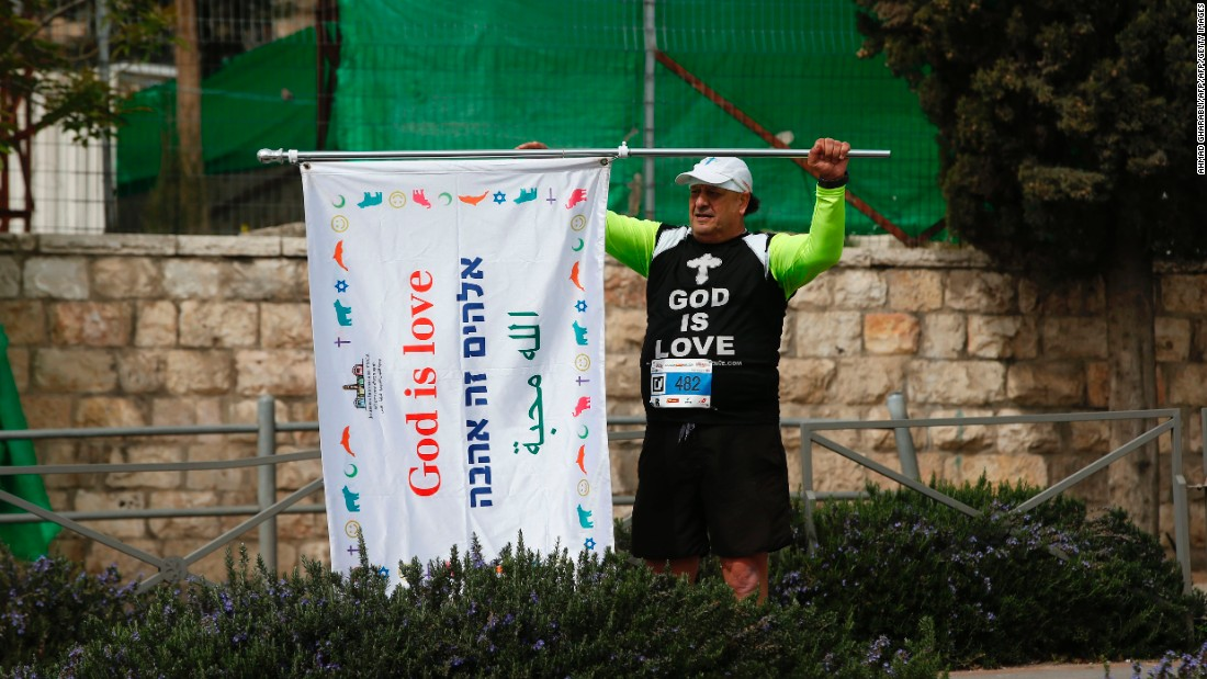 "This competitor carried a flag with the message, ""God is love."""