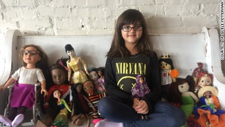 Grace, who is 5, with her dolls.