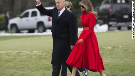 US President Donald Trump, First Lady Melania Trump and their son, Barron, walk to Marine One prior to departing from the South Lawn of the White House in Washington, DC, Friday.