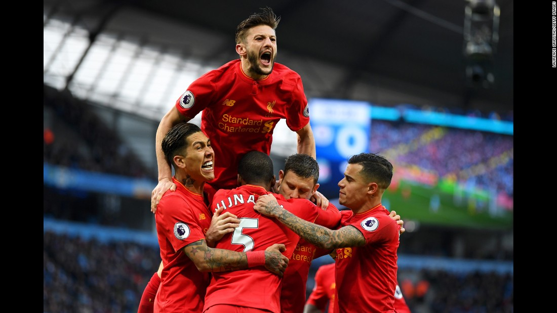 Liverpool players celebrate after James Milner's goal against Manchester City on Sunday, March 19. The Premier League match ended 1-1 in Manchester, England.