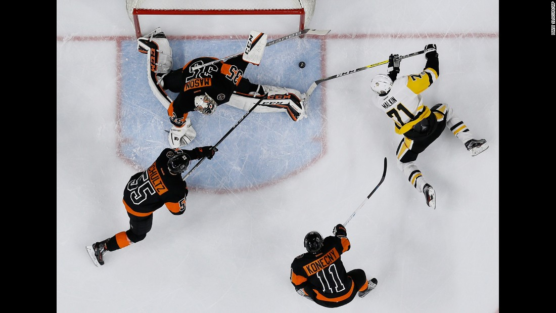 Pittsburgh's Evgeni Malkin, right, is denied by Philadelphia goalie Chris Mason during an NHL hockey game on Wednesday, March 15. Mason and the Flyers shut out their in-state rivals 4-0.