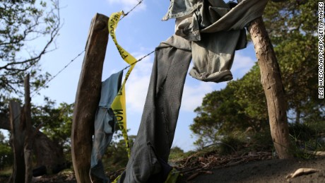 TOPSHOT - Clothing is seen on March 19, 2017 around a mass grave where 12 bodies were exhumed Friday by the authorities in El Arbolillo village in Alvarado, Veracruz state, Mexico.  / AFP PHOTO / ILSE HUESCA        (Photo credit should read ILSE HUESCA/AFP/Getty Images)