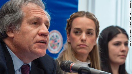 Organization of American States (OAS) Secretary General Luis Almagro (L) listens as wife of Venezuelan political prisoner Lilian Tintori (C) speaks, as Oriana Goicoechea looks on during a press conference on March 20, 2017 at OAS headquarters in Washington, DC.  / AFP PHOTO / PAUL J. RICHARDS        (Photo credit should read PAUL J. RICHARDS/AFP/Getty Images)