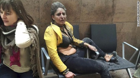In this March 22, 2016 file photo provided by photographer Ketevan Kardava, Nidhi Chaphekar, a Jet Airways flight attendant from Mumbai, right, and another unidentified woman are shown after being wounded in Brussels Airport in Brussels, Belgium, after explosions rocked the airport. Chaphekar said she has recovered 70 percent of her previous fitness level and would like to resume her passion, flying. (Ketevan Kardava via AP, File)