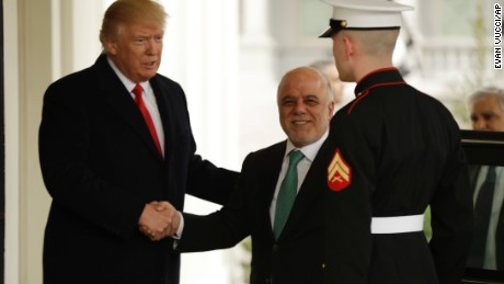 US President Donald Trump greets Iraqi Prime Minister Haider al-Abadi upon his arrival to the White House in Washington, DC on Monday.