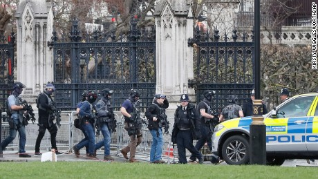 Armed police officers enter the Houses of Parliament in London, Wednesday, March 23, 2017 after the House of Commons sitting was suspended as witnesses reported sounds like gunfire outside.(AP Photo/Kirsty Wigglesworth)