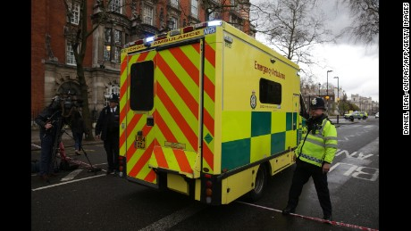 An ambulance is driven through a police cordon outside the Houses of Parliament in central London on March 22, 2017 during an emergency incident. Britain's Houses of Parliament were in lockdown on Wednesday after staff said they heard shots fired, triggering a security alert. / AFP PHOTO / DANIEL LEAL-OLIVAS        (Photo credit should read DANIEL LEAL-OLIVAS/AFP/Getty Images)