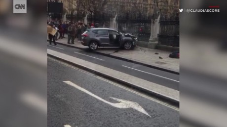 Crashed car smokes outside Parliament