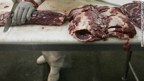 Sao Paulo, BRAZIL: An employee slices beef at a supermarket, in Sao Paulo, Brazil, 30 May 2007. The Brazilian group JBS-Friboi, Latin America's main producer and exporter of bovine meat, announced the acquisition of the American company Swift Foods by 1,400 million dollars, giving rise to the birth of a giant of the branch. Brazil has the world's biggest flock, with near 200 million heads, according to the minister of Agriculture, and has become the first world-wide exporter in the last years, surpassing the United States and Australia. AFP PHOTO/Mauricio LIMA (Photo credit should read MAURICIO LIMA/AFP/Getty Images)