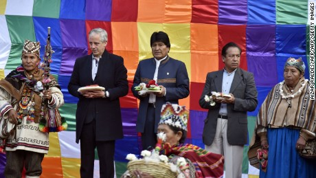 Bolivian President Evo Morales (C), Vice-President Alvaro Garcia Linera (L) and the Minister of the Presidency Rene Martinez take part in an Andean ritual performed at a square in La Paz on March 21, 2017 as Morales's government submitted its response to a counter-suit filed by Chile at the International Court of Justice (ICJ), the latest legal wrangling in landlocked Bolivia's long-standing struggle to regain access to the Pacific Ocean. The two countries, currently locked in a bitter border dispute at the ICJ, severed diplomatic ties in 1978 and have a beef dating back to the War of the Pacific in the 19th century, when Bolivia lost its access to the sea to Chile. / AFP PHOTO / Aizar RALDES        (Photo credit should read AIZAR RALDES/AFP/Getty Images)