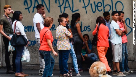 People line up to buy bread in Caracas amid shortages and skyrocketing prices on all types of goods.