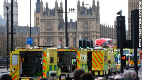 Ambulances wait as medics aid people on Westminster Bridge, near Parliament in central London, after an attack on March 22.