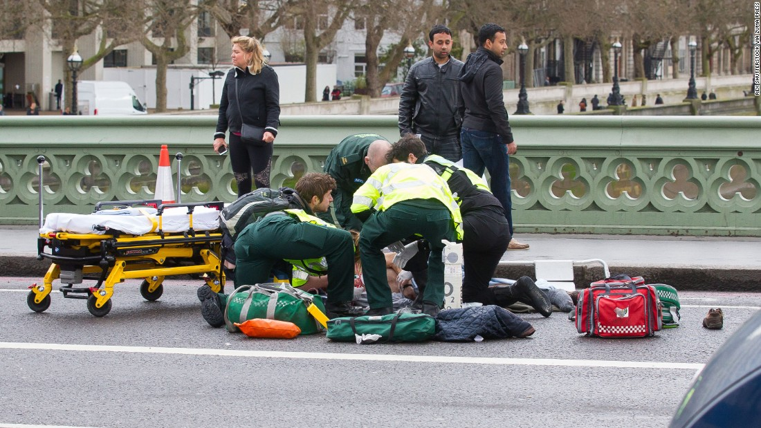 Medics treat a victim on Westminster Bridge.