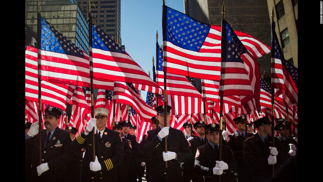 Firefighters march up Fifth Avenue in New York  during the St. Patrick's Day Parade on Friday, March 17.