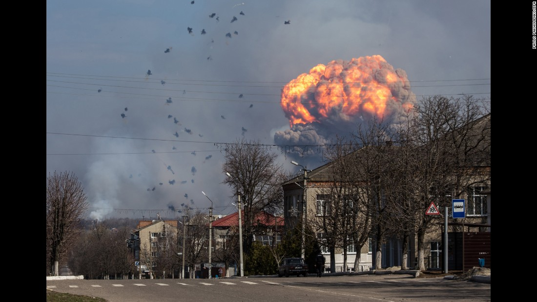 "A fire erupts at the site of a Ukrainian Armed Forces ammunition depot near Balakiya, in Ukraine's Kharkiv region, on Thursday, March 23. <a href=""http://hosted.ap.org/dynamic/stories/E/EU_UKRAINE_FIRE?SITE=AP&SECTION=HOME&TEMPLATE=DEFAULT"" target=""_blank"">According to The Associated Press</a>, around 20,000 people were evacuated after the fire."