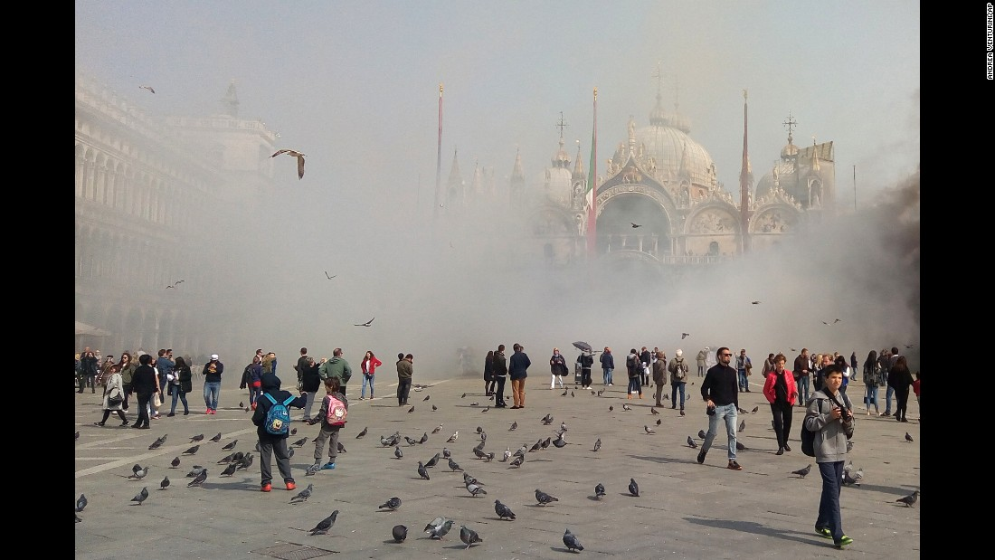 Smoke rises in St. Mark's Square in Venice, Italy, on Friday, March 17. According to news reports, alleged thieves set off smoke bombs in the area while attempting a robbery.