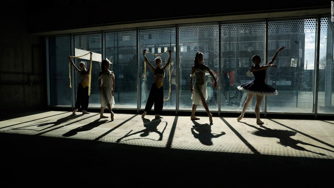 "Dancers from the Central School of Ballet pose for photographers in the unfinished interior of their new Paris Gardens building in London on Tuesday, March 21. <a href=""https://www.southwarknews.co.uk/news/ballet-school-raises-barre-high-6m-push-new-home/"" target=""_blank"">According to a local news outlet</a>, the school is undertaking a £6 million pound (about $7.5 million US) fundraising campaign to finish the building developments and is going on a five-month tour around Britain."