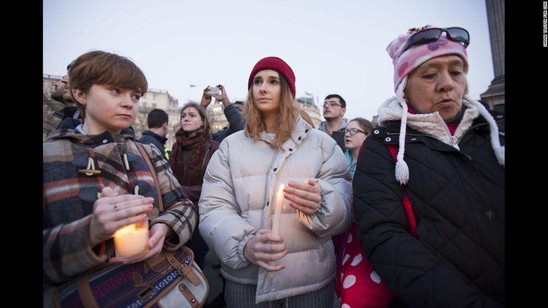 "A crowd gathers in Trafalgar Square on Thursday, March 23, for a candlelit vigil to honor the victims of Wednesday's attack near Parliament in London. Emily Nye, a 21-year-old student at Goldsmiths, University of London, (center) says she was ""devastated, but not surprised"" to hear of the rampage."