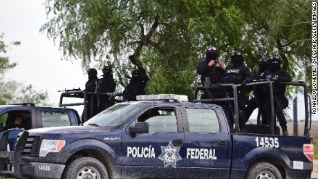 Patrols of the Mexican Federal police are pictured at the highway between Matamoros and Ciudad Victoria in Tamaulipas State, on December 16, 2015. The Federal police escort travellers crossing the dangerous highway of the gang-infested north eastern state of Tamaulipas, from the border with the United States. AFP PHOTO/RONALDO SCHEMIDT / AFP / RONALDO SCHEMIDT        (Photo credit should read RONALDO SCHEMIDT/AFP/Getty Images)