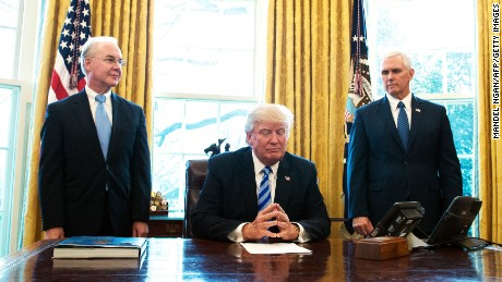 US President Donald Trump, with Vice President Mike Pence and Health and Human Services Secretary Tom Price, pauses as he speaks from the Oval Office of the White House in Washington, DC, on March 24, 2017. Trump on Friday asked US Speaker of the House Paul Ryan to withdraw the embattled Republican health care bill, moments before a vote, signaling a major political defeat for the US president.