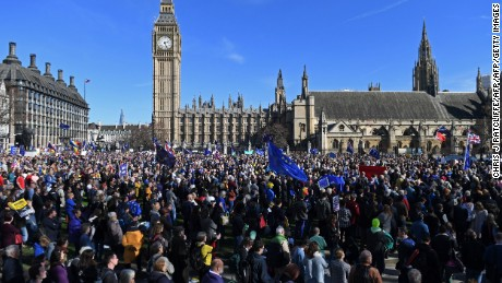 Demonstrators with EU flags gather Saturday near the Houses of Parliament in London.