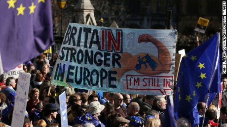 "Demonstrators hold a placard that reads, ""Britain stronger in Europe,"" during the march."