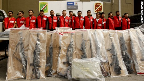 "Fourteen alleged members of ""Los Zetas"" drug cartel and seized weapons are presented to the press in Monterrey, Nuevo Leon state, Mexico on February 15, 2012. More than 40,000 people have been killed in rising drug-related violence in Mexico since December 2006, when President Felipe Calderon deployed soldiers and federal police to take on organized crime. AFP PHOTO/Julio Cesar AGUILAR (Photo credit should read Julio Cesar Aguilar/AFP/Getty Images)"