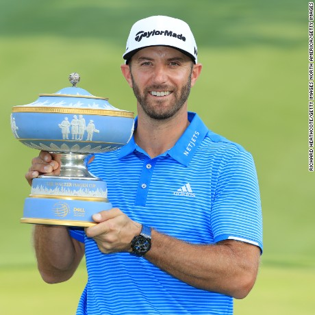 Dustin Johnson poses with the trophy after winning the World Golf Championships-Dell Technologies Match Play at the Austin Country Club (Photo by Richard Heathcote/Getty Images)