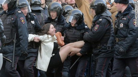This image of Russian riot police detaining a demonstrator has been widely shared on social media.