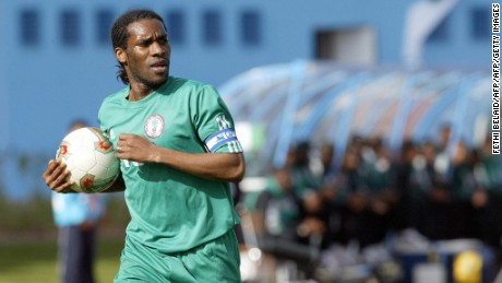 MONASTIR, TUNISIA:  NIgeria's captain Augustine Jay-Jay Okocha walks holding the ball 31 January 2004 at the stadium in Monastir during his African Nation Cup match against South Africa. AFP PHOTO FRANCK FIFE  (Photo credit should read FETHI BELAID/AFP/Getty Images)