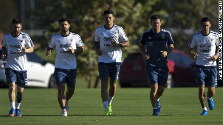 (L t R) Argentina's forward Lionel Messi (L), forward Sergio Aguero, defender Marcos Rojo and midfielder Angel Di Maria  jog during in a training session in Ezeiza, Buenos Aires on March 25, 2017 ahead of a 2018 FIFA World Cup Russia South American qualifier football match against Bolivia to be held in La Paz on March 28. / AFP PHOTO / EITAN ABRAMOVICH        (Photo credit should read EITAN ABRAMOVICH/AFP/Getty Images)