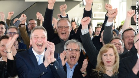 Supporters of the Christian Democratic Union (CDU) react after exit poll results  in Saarland were announced on March 26, 2017.