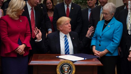 President Donald Trump speaks after signing H.J. Resolution 37, 44, 57 and 58 at the White House in Washington, DC, on March 27, 2017.