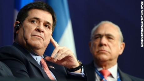 Paraguay's President Horacio Cartes, flanked by OECD Secretary General Angel Gurria (R), listens during the Latin America and Caribbean International economic forum at the Economy Ministry in Paris on June 3, 2016. / AFP / ERIC PIERMONT        (Photo credit should read ERIC PIERMONT/AFP/Getty Images)