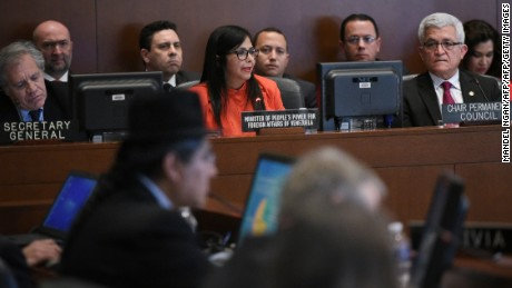 Venezuela's Foreign Minister Delcy Rodríguez (C) speaks during an address to the Organization of American States (OAS) on March 27, 2017 in Washington, DC, as  OAS Secretary General Luis Almagro(L) looks on.  / AFP PHOTO / MANDEL NGAN        (Photo credit should read MANDEL NGAN/AFP/Getty Images)