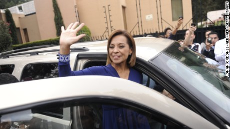 The Mexican presidential candidate for the National Action Party (PAN), Josefina Vazquez Mota, waves after casting her vote in Huisquilucan, Mexico State, during election day on July 1, 2012. Almost 80 million Mexicans are expected to vote in Mexico's presidential election, in which voters exhausted by violence seem prepared to bring the PRI, the party that ran the country for seven decades, back to office. Mexican presidents are elected by simple majority for six-year terms and are banned from running for re-election.  AFP PHOTO/Johan ORDONEZ        (Photo credit should read JOHAN ORDONEZ/AFP/GettyImages)