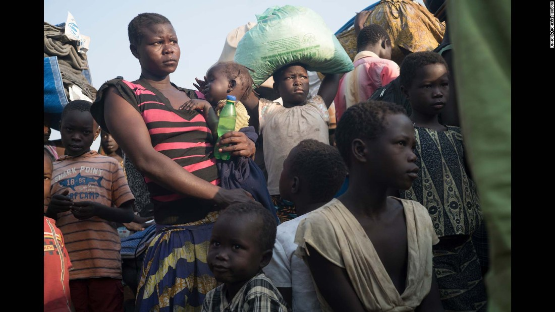 A South Sudanese family moving from Palorinya reception centre, which has a capacity of 3000 people to the Palorinya settlements where each family will be given a piece of land for shelter.