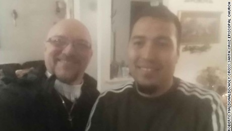 Francisco Rodriguez Dominguez (right) meets his priest after getting released from ICE detention.