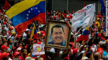 Supporters of Venezuelan President Nicolas Maduro take part in a rally against the secretary general of the Organization of American States (OAS), Luis Almagro, in Caracas on March 28, 2017. / AFP PHOTO / FEDERICO PARRA        (Photo credit should read FEDERICO PARRA/AFP/Getty Images)