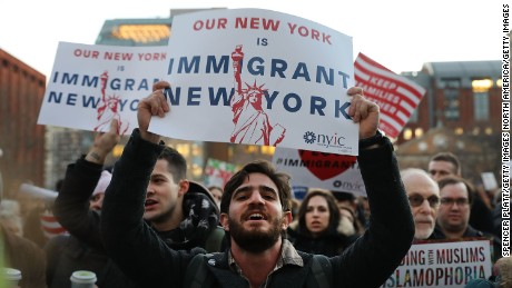 "NEW YORK, NY - JANUARY 25:  Hundreds of people attend an evening rally at Washington Square Park in support of Muslims, immigrants and against the building of a wall along the Mexican border on January 25, 2017 in New York City. President Donald Trump took actions today to start the building of a long promised wall along the Mexican border and to cut federal grants for immigrant protecting ""sanctuary cities"".  (Photo by Spencer Platt/Getty Images)"