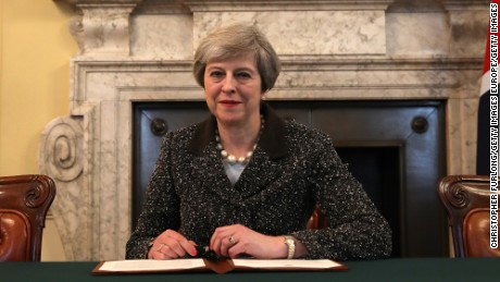 UK Prime Minister Theresa May signs the letter that officially kicked off Brexit in late March.