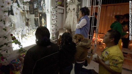 Santa Muerte devotees pray at the shrine in Tepito.