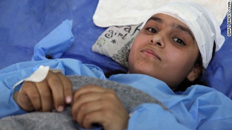 16-year-old Fatima lies in a bed at a the same Erbil hospital with a broken back. She was injured in an airstrike in the last two weeks though she doesn't recall specifically which. She only remembers being pulled out of the rubble afterwards.