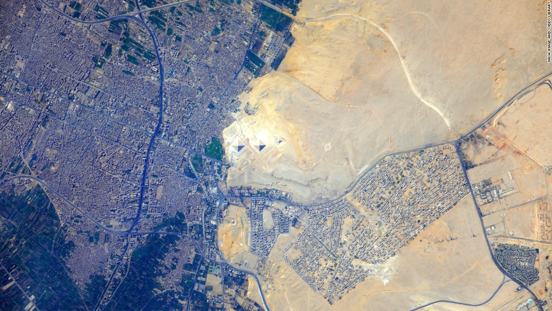 The pyramids at Giza can be seen in the center of this image taken from the International Space Station in 2012, with the modern Cairo metropolitan area to the left and the Sahara desert on the right.