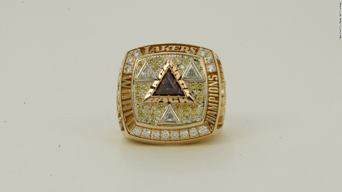 "Triangles were the theme of the Los Angeles Lakers' championship ring in 2001-02. The triangles signify the team's third consecutive world title -- and they're also a nod to the team's ""triangle"" offense."