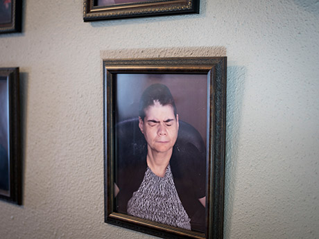 Lesli's portrait hangs on the wall at the group home where she lives.