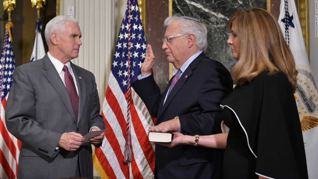 US Vice President Mike Pence, left, swears in David Friedman as the US ambassador to Israel on Wednesday, March 29. Friedman's wife, Tammy Sand, looks on.