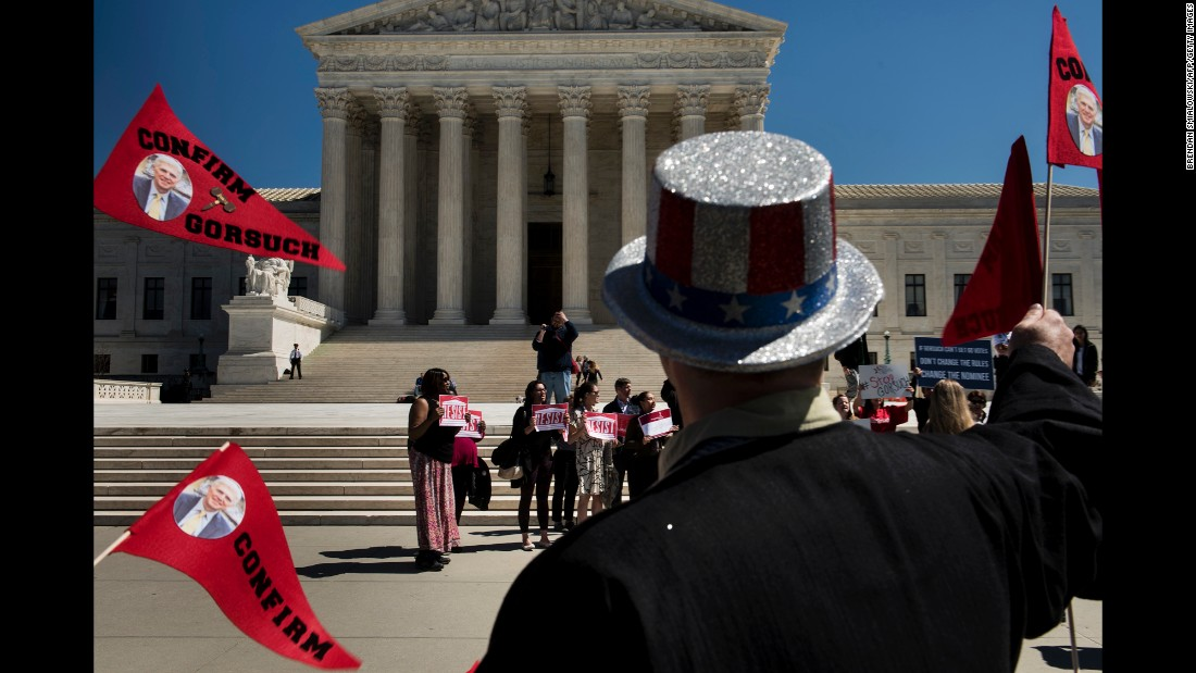 "People gather in front of the US Supreme Court to protest and support the nomination of Neil Gorsuch on Wednesday, March 29. The Senate plans to <a href=""http://www.cnn.com/2017/03/28/politics/mitch-mcconnell-neil-gorsuch-confirmation/index.html"" target=""_blank"">vote on Gorsuch </a>on April 7, according to Majority Leader Mitch McConnell."